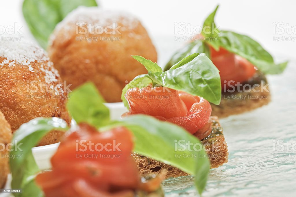 Salmon canape with basil royalty-free stock photo