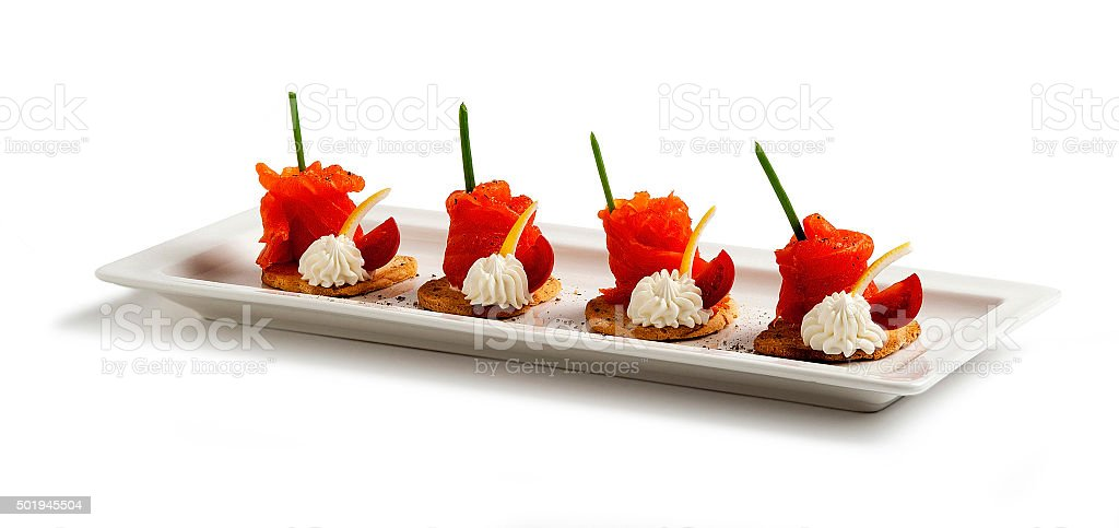 Salmon canapes in white plate stock photo