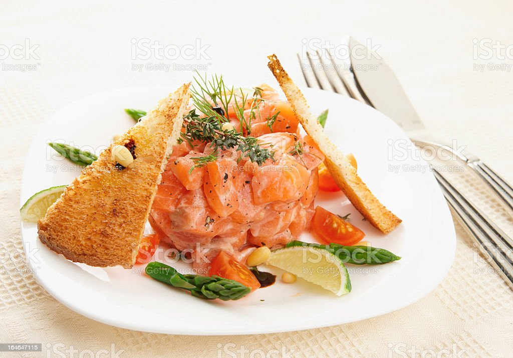 Salmon carpaccio with asparagus and bread plated nicely royalty-free stock photo