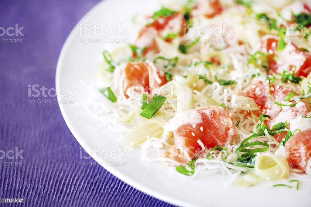 Salmon ceviche on fried vermicelli noodles, scallions and sesame royalty-free stock photo