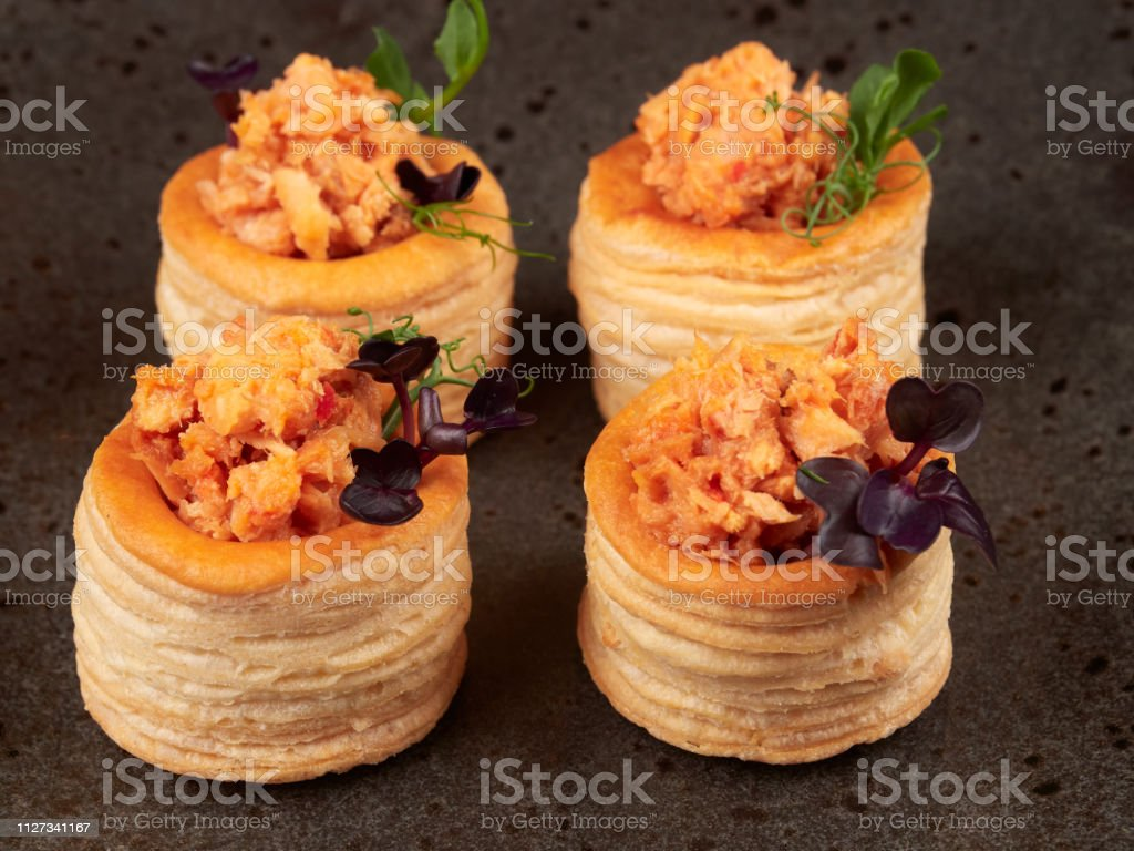 Salmon filled puff pastries or vol-au-vent stock photo