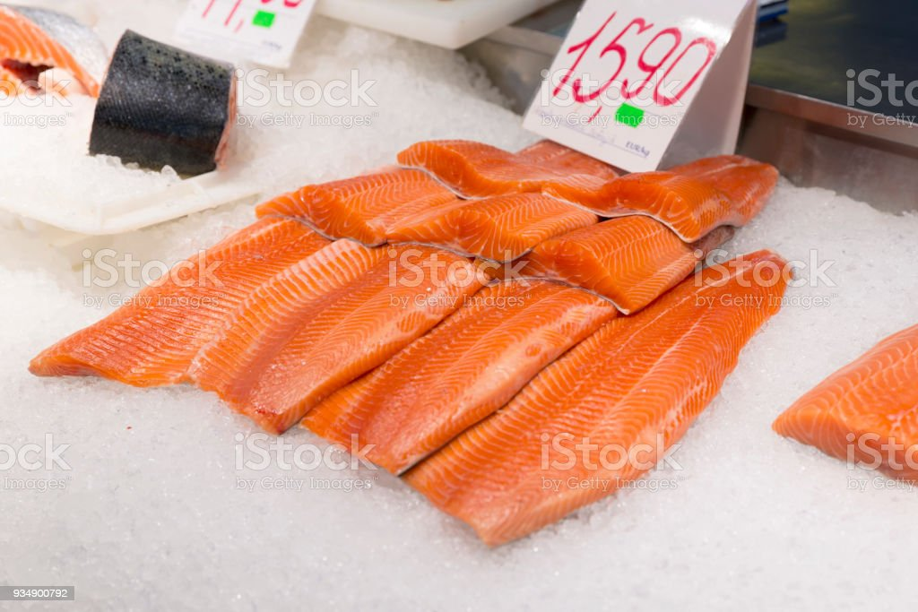 Salmon fillet at fish market. Fresh fish and healthy meal rich in unsaturated fat. Healthy meal stock photo