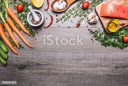 istock Salmon fillet delicious ingredients cooking  vegetables herbs, salt  wooden spoon, 503054322