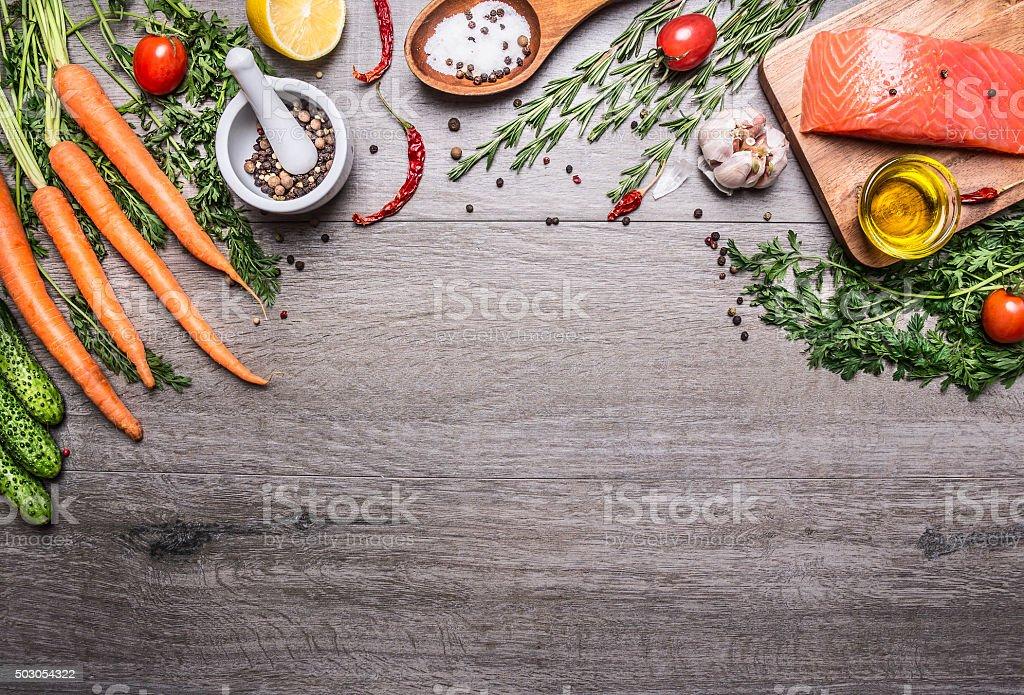Salmon fillet delicious ingredients cooking  vegetables herbs, salt  wooden spoon, stock photo