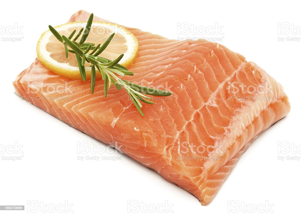 Salmon fillet isolated on white with lemon and herbs stock photo
