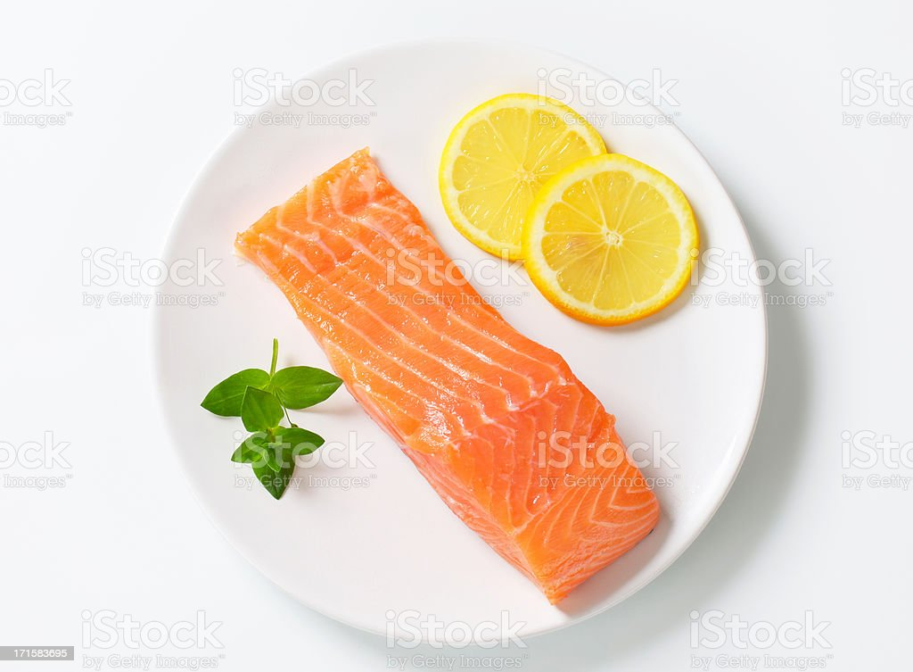 salmon fillet on a plate stock photo