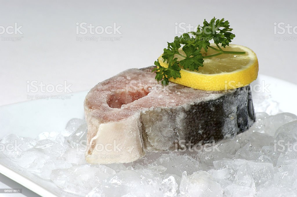 salmon fillet on crushed ice with lemon royalty-free stock photo
