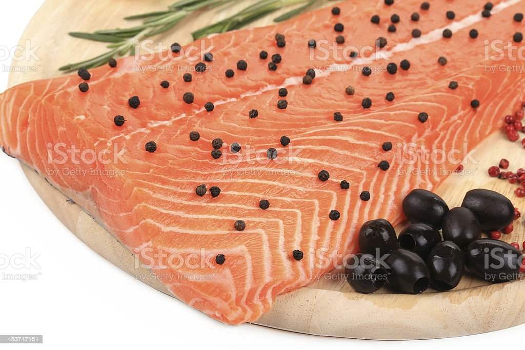 Salmon fillet on platter with olives. royalty-free stock photo