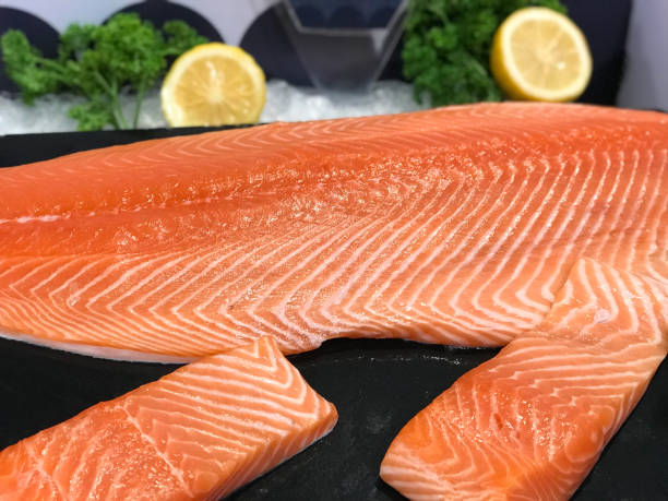 Salmon fillet portions selling in supermarket Salmon fillet portions decorating with lime and vegetable atlantic salmon stock pictures, royalty-free photos & images