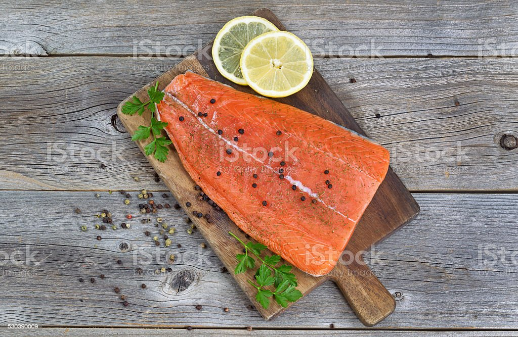 Salmon Fillet seasoned and ready for cooking stock photo