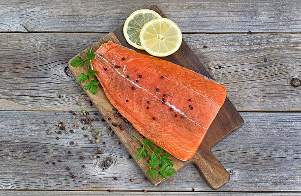 salmon fillet seasoned and ready for cooking - chinook salmon stock photos and pictures