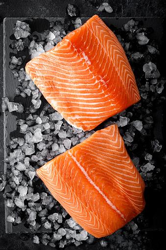 Salmon fillet. Slices of fresh raw salmon fish on ice