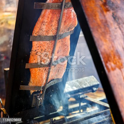 Salmon smoked on a wood board at the Budapest Christmas Market