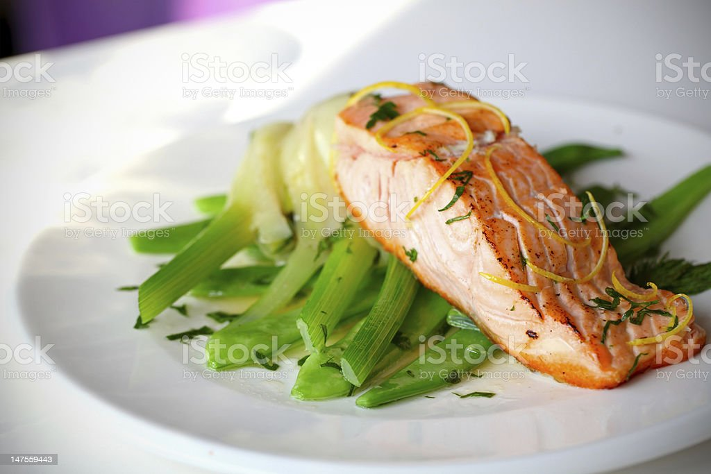 Salmon fillet with green beans and lemon zest. royalty-free stock photo