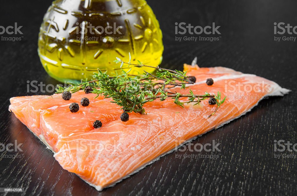 Salmon fillet with pepper  isolated on black wood photo libre de droits