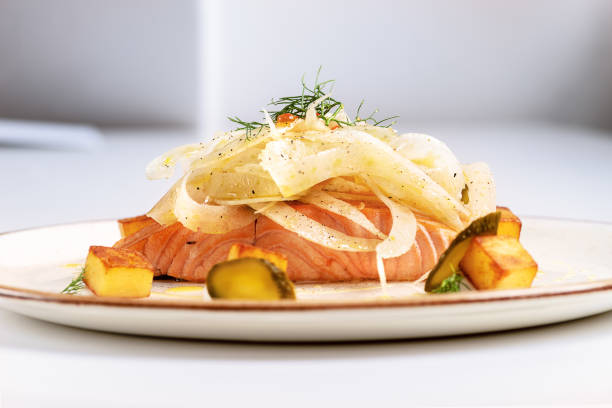 Salmon fillet with salad of fennel on resturant - foto stock