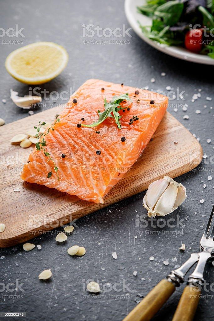 Salmon fish on cutting board stock photo