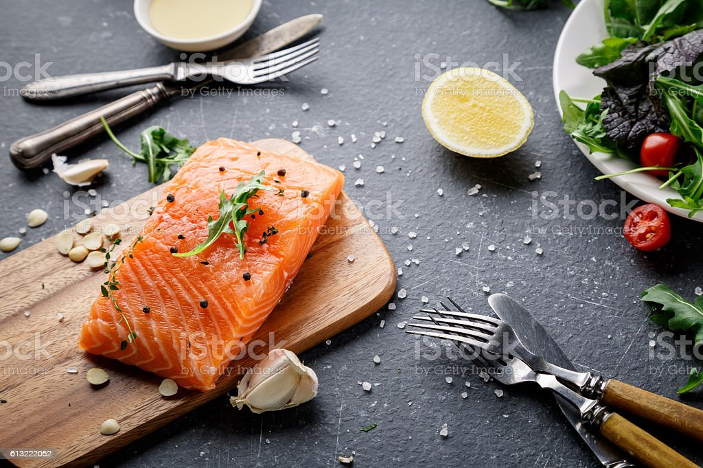 Salmon fish on the cutting board stock photo