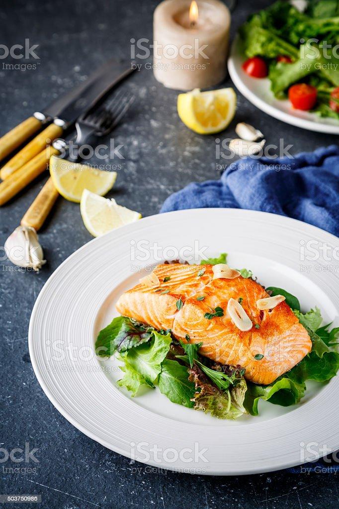 Salmon fish on white plate stock photo