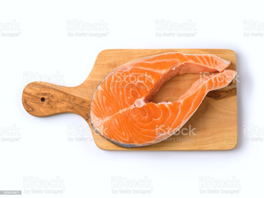 Salmon fish on wooden cutting board stock photo