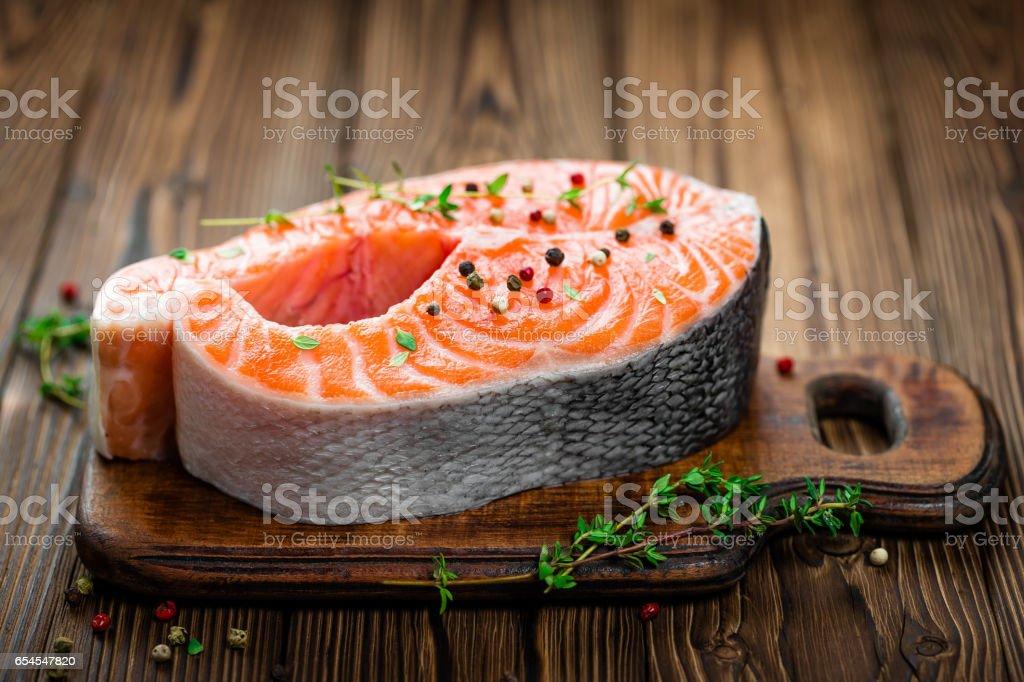 Salmon fish steak on wooden background stock photo