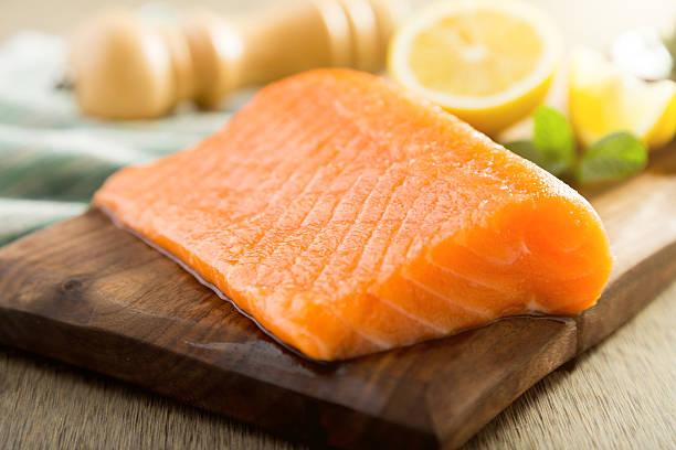 Salmon fish steck on the cutting board Salmon fish steck on the cutting board salmonidae stock pictures, royalty-free photos & images