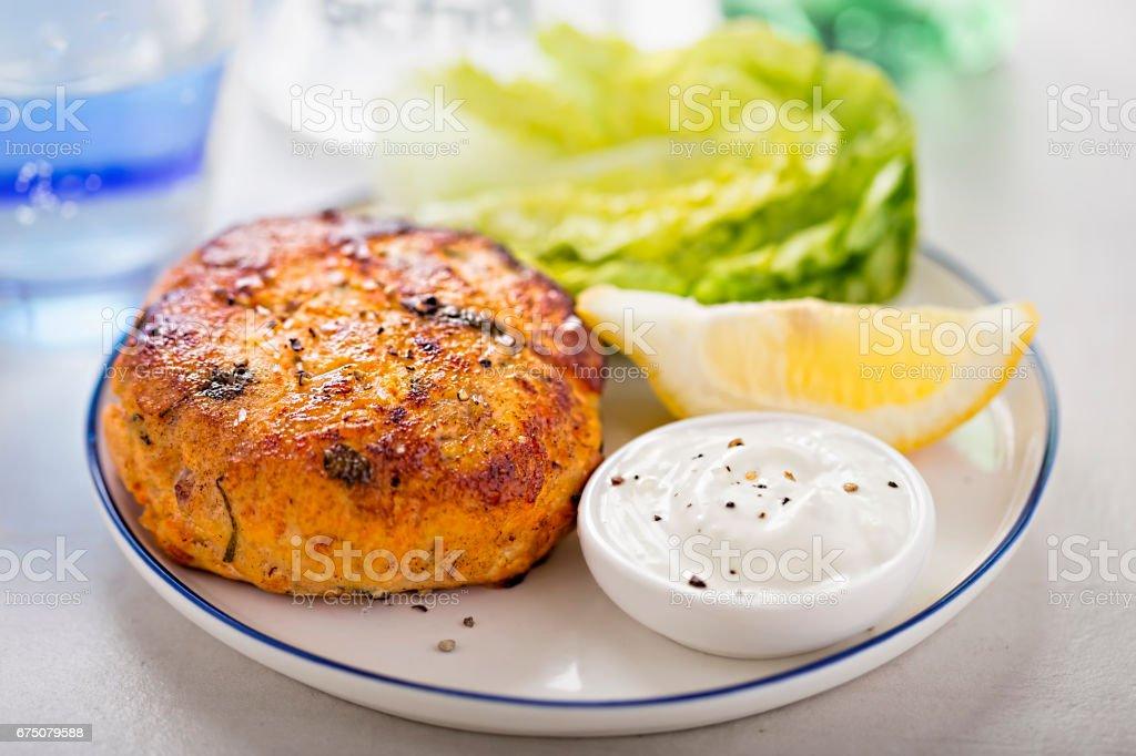 Salmon fishcake burger with mayo and lettuce stock photo