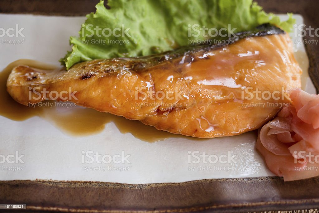 Salmon fried with Japanese sauce royalty-free stock photo