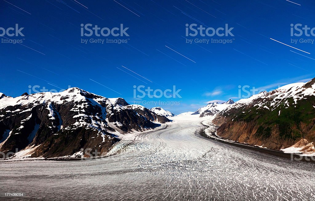 Salmon Glacier and  star trail stock photo