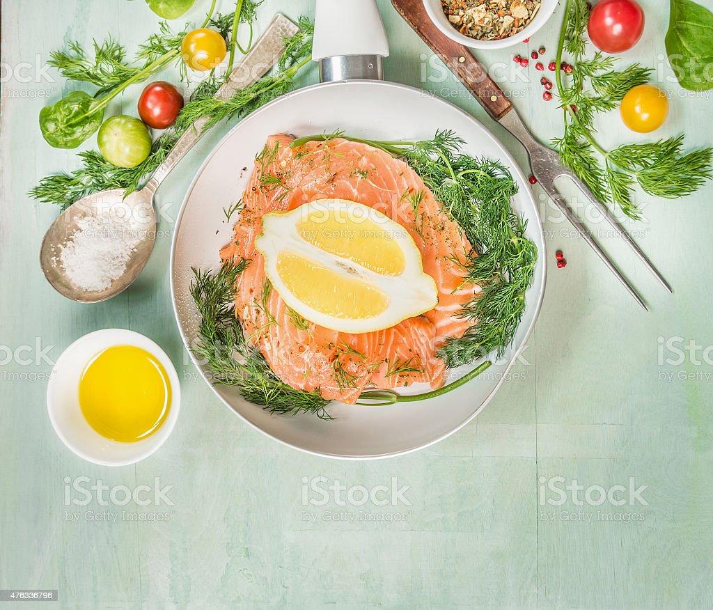 Salmon in white Frying pan with oil, fresh seasoning stock photo