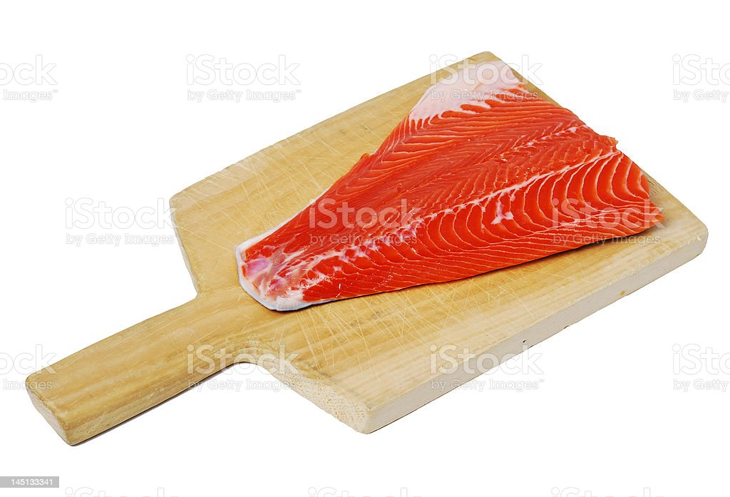 Salmon on a cutting board royalty-free stock photo