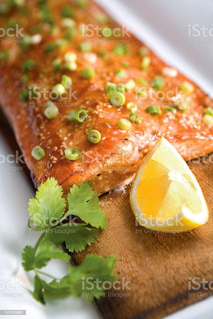 Salmon on a Plank stock photo