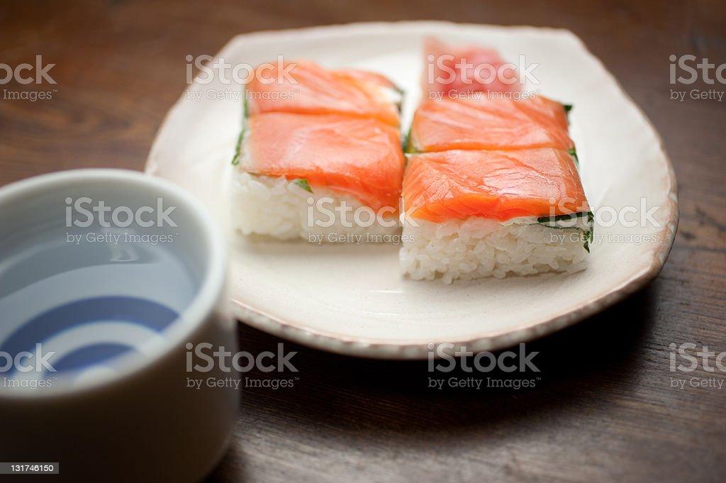 Salmon oshizushi and sake. royalty-free stock photo