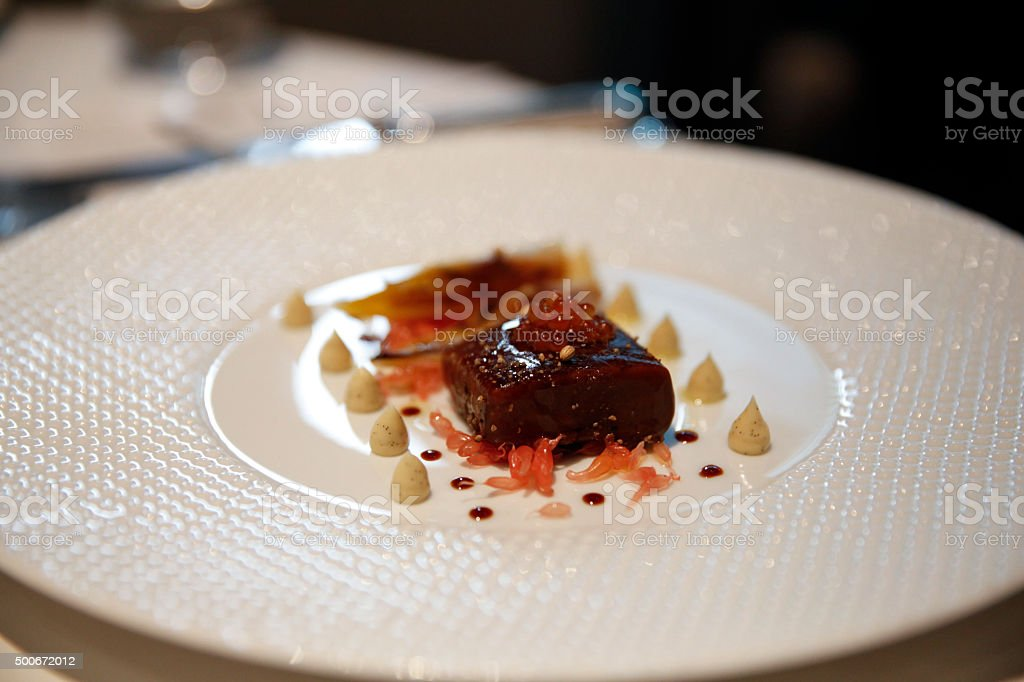 Salmon poached in liquorice gel stock photo