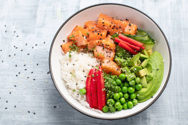 Salmon poke bowl stock photo