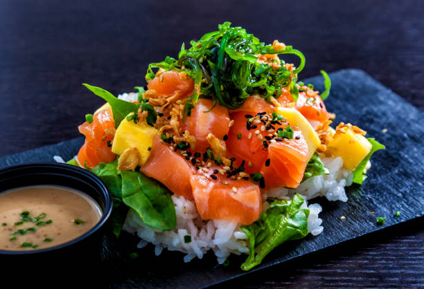 Salmon poke Salmon poke served on a slate. asian food stock pictures, royalty-free photos & images