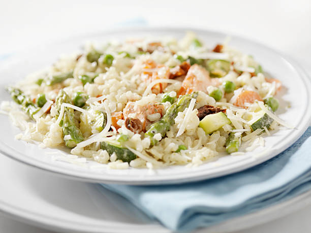 Salmon Risotto Primavera Risotto Primavera with Asparagus and Green Peas -Photographed on Hasselblad H1-22mb Camera primavera stock pictures, royalty-free photos & images