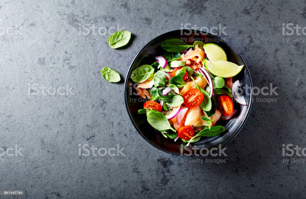 Salmon salad with baby spinach and corn salad stock photo
