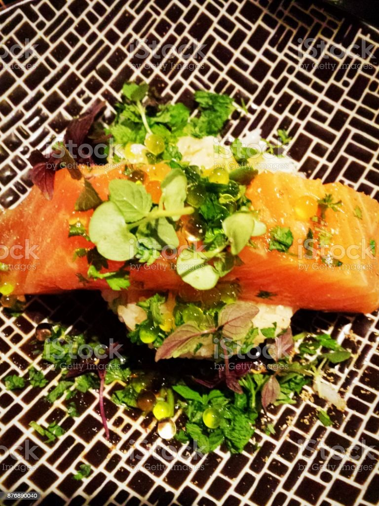Salmon sashimi with pearls of lime modern french cuisine stock photo
