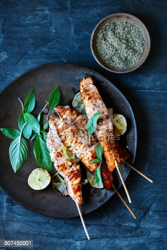 Salmon satay with basil and herbs