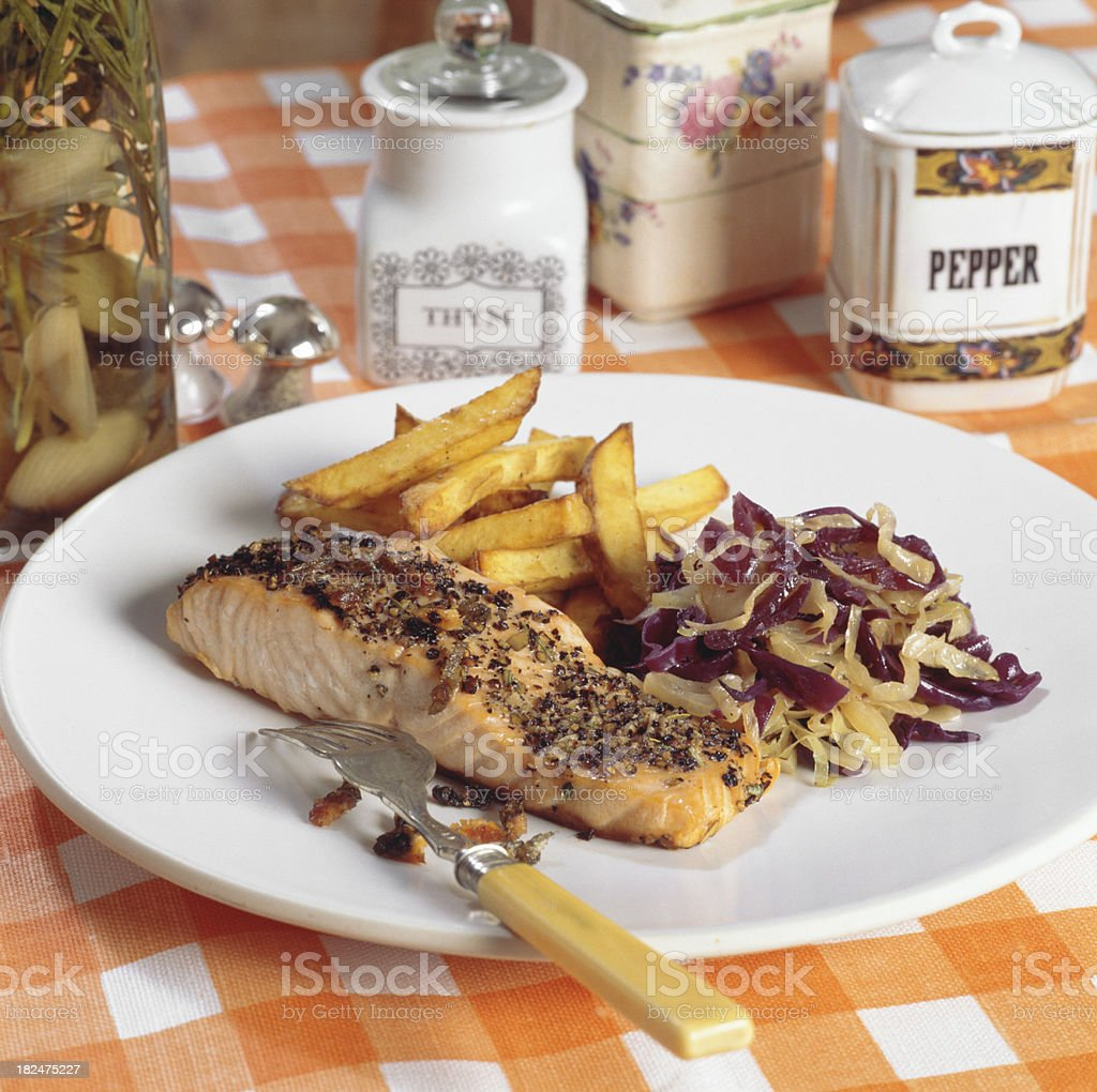 Salmon served with chips royalty-free stock photo