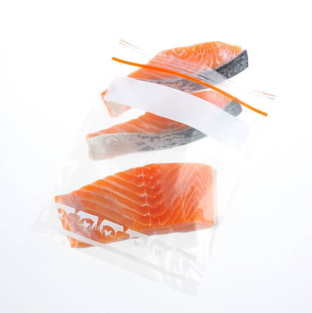 Salmon slice in a safe zipper bag stock photo