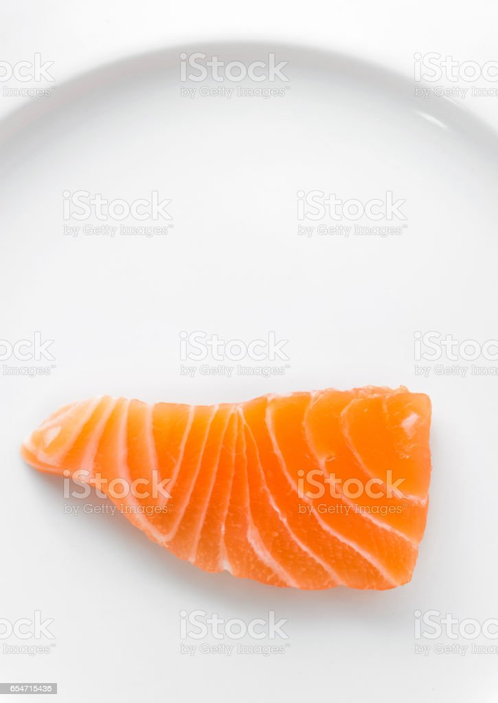 salmon sliced on a white plate stock photo