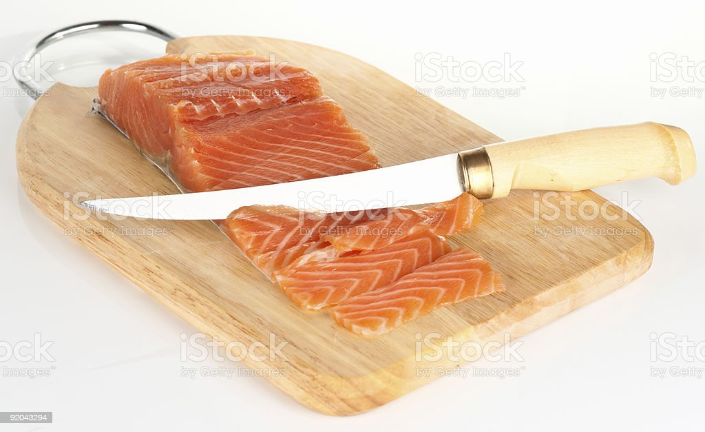 Salmon sliced with Finnish fillet knife royalty-free stock photo