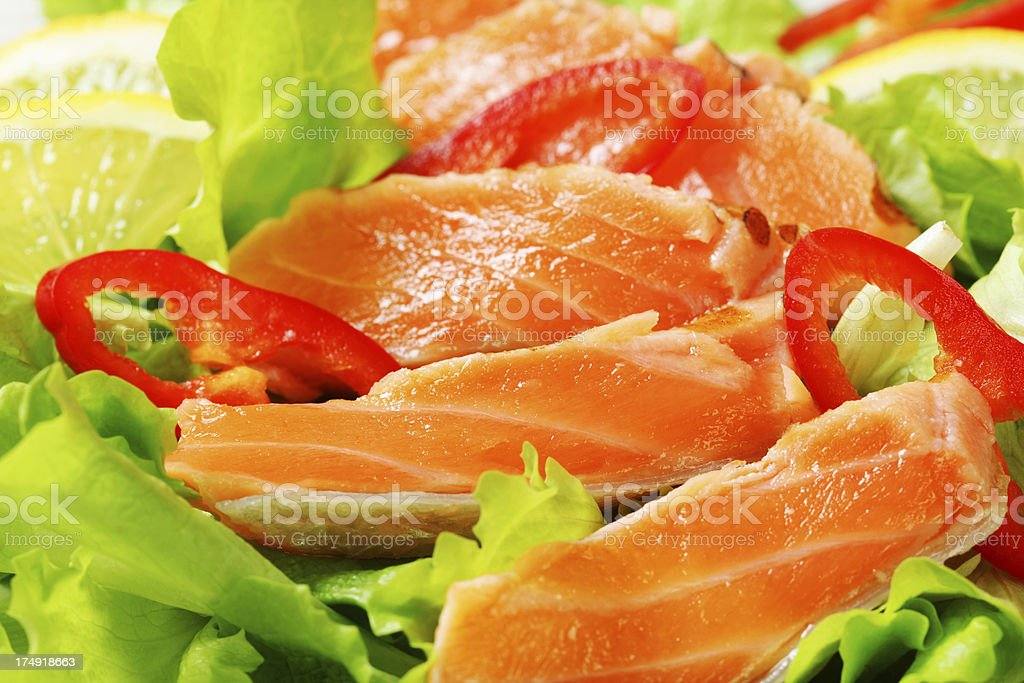 salmon slices in lettuce royalty-free stock photo