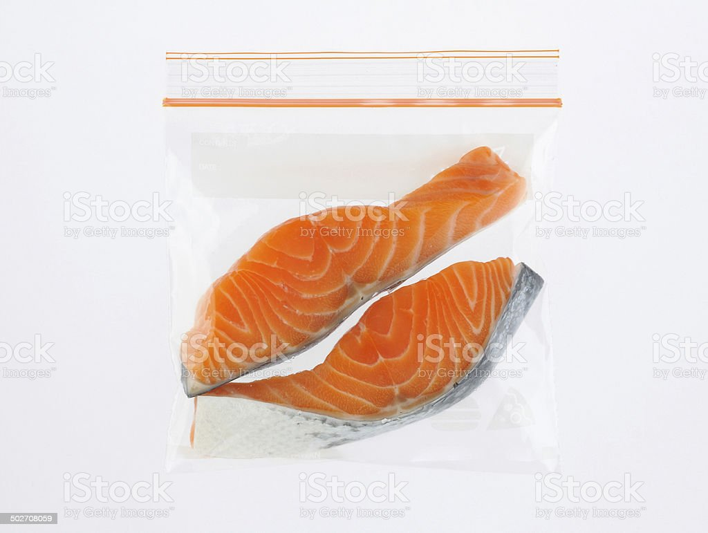 Salmon slices in preservation freezer bag stock photo