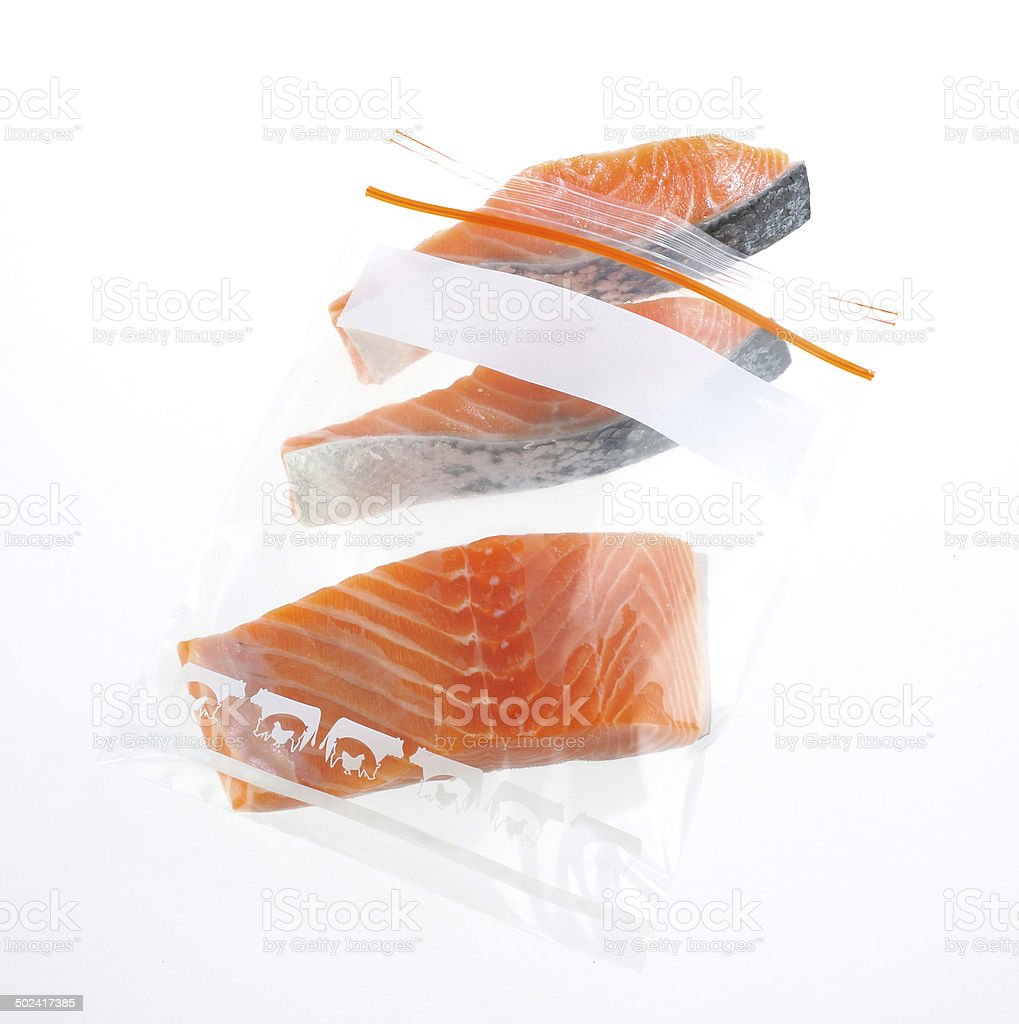 Salmon slices in preservation zipper bag stock photo