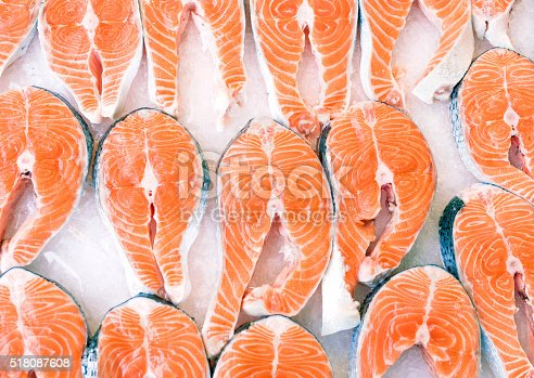 salmon slices on crushed ice - fresh raw meat