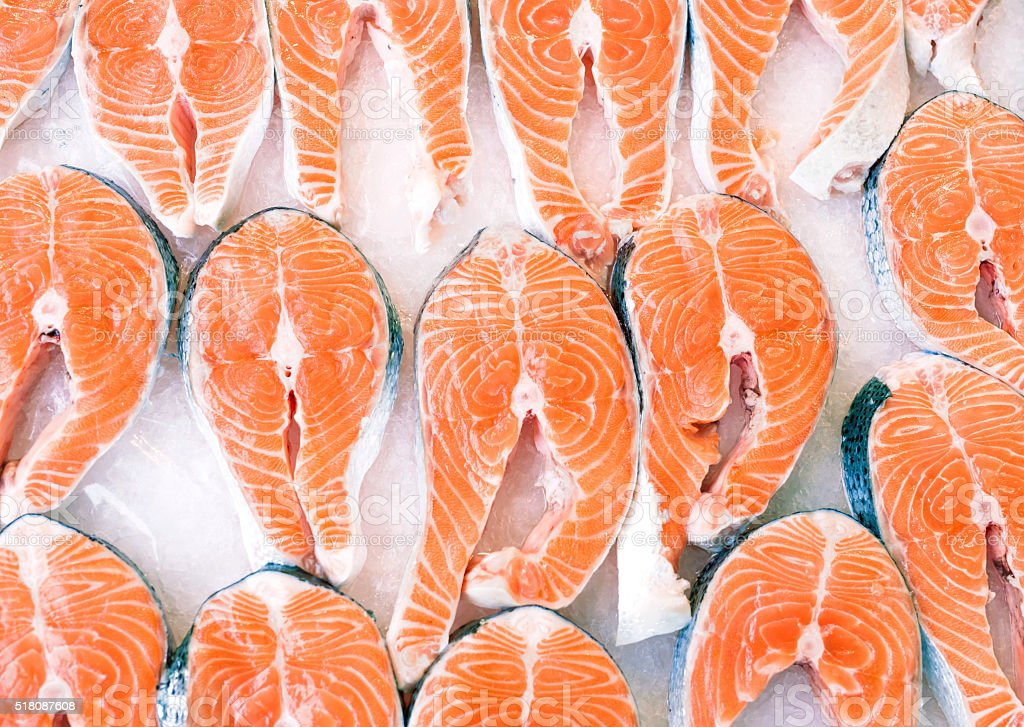 salmon slices on ice stock photo