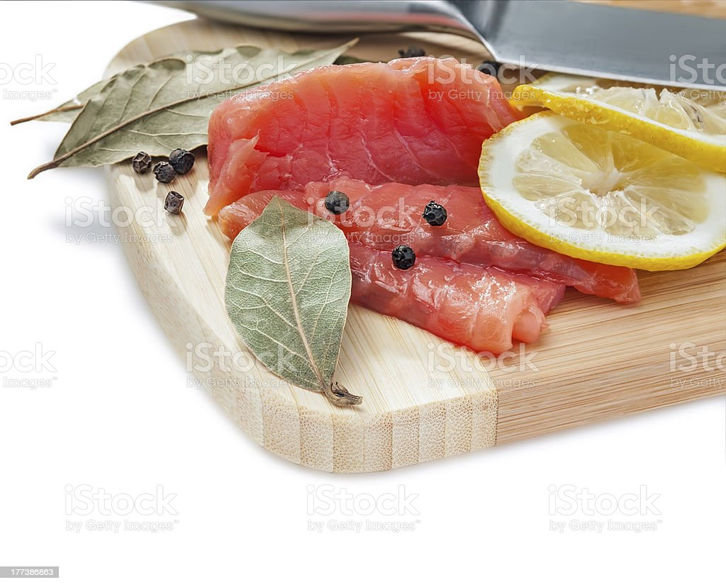 Salmon slices on the wooden board royalty-free stock photo